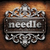 Needle vector metal word on wood — Stockvector