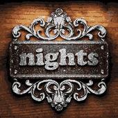 Nights vector metal word on wood — Stock Vector