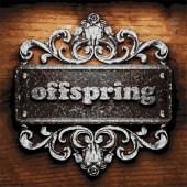 Offspring vector metal word on wood — Stock Vector