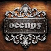 Occupy vector metal word on wood — Stock Vector