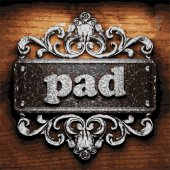 Pad vector metal word on wood — Stock Vector