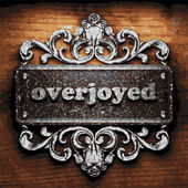 Overjoyed vector metal word on wood — Stock Vector
