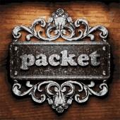 Packet vector metal word on wood — Stock Vector