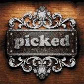 Picked vector metal word on wood — Stock Vector