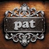 Pat vector metal word on wood — Stock Vector