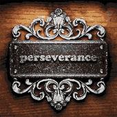 Perseverance vector metal word on wood — Stock Vector