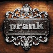Prank vector metal word on wood — Stock Vector