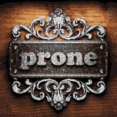 Prone vector metal word on wood — Stock Vector