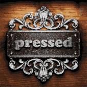 Pressed vector metal word on wood — Stock Vector