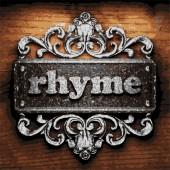 Rhyme vector metal word on wood — Stock Vector