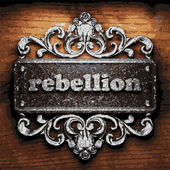 Rebellion vector metal word on wood — Stockvektor