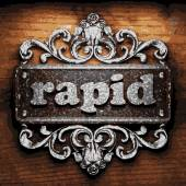 Rapid vector metal word on wood — Stock Vector