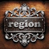 Region vector metal word on wood — Stock Vector