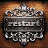 Restart vector metal word on wood — Stock Vector