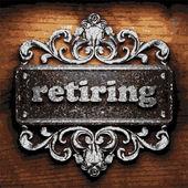 Retiring vector metal word on wood — Stock Vector