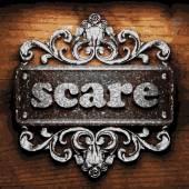Scare vector metal word on wood — Stock Vector