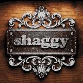 Shaggy vector metal word on wood — Stock Vector