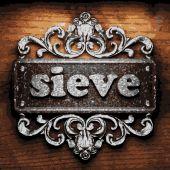 Sieve vector metal word on wood — Stock Vector