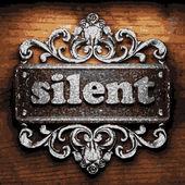 Silent vector metal word on wood — Stock Vector