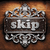 Skip vector metal word on wood — Stock Vector