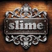 Slime vector metal word on wood — Stock Vector