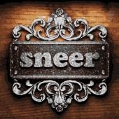 Sneer vector metal word on wood — Stock Vector