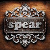 Spear vector metal word on wood — Stock Vector