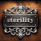 Sterility vector metal word on wood — Stock Vector