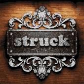 Struck vector metal word on wood — Stock Vector