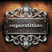 Superstition vector metal word on wood — Stock vektor