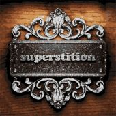 Superstition vector metal word on wood — Stockvector