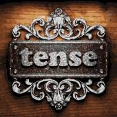 Tense vector metal word on wood — Vettoriale Stock