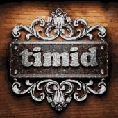 Timid vector metal word on wood — Stock Vector
