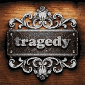 Tragedy vector metal word on wood — Stock Vector