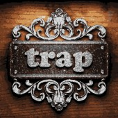 Trap vector metal word on wood — Stock Vector