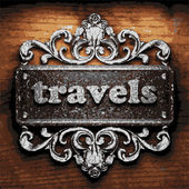 Travels vector metal word on wood — Stock Vector