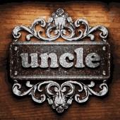 Uncle vector metal word on wood — Vecteur
