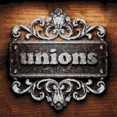 Unions vector metal word on wood — Stock Vector
