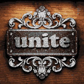 Unite vector metal word on wood — Stock Vector