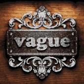 Vague vector metal word on wood — Stock Vector