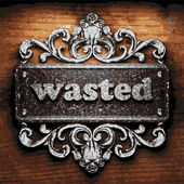 Wasted vector metal word on wood — Stockvektor
