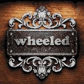 Wheeled vector metal word on wood — Stock Vector