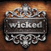 Wicked vector metal word on wood — Stock Vector