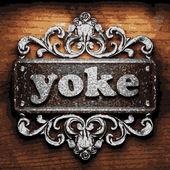 Yoke vector metal word on wood — Stock Vector