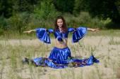 Beautiful woman in long dress posing — Foto Stock