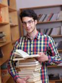 Teenager in library — Stock Photo