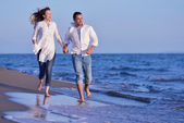 Young couple  on beach have fun — Stock Photo