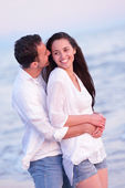 Young couple  on beach have fun — Stockfoto