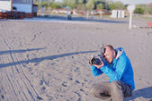 Photographer taking photo on beach — Stock Photo