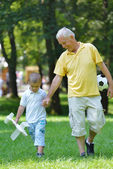 Happy grandfather and child in park — Stock Photo